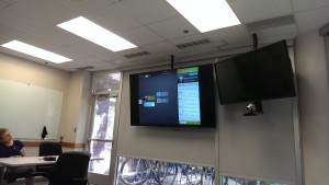At one stop on their tour of the Ancestry campus, a Team Member explained to Shar Mansukhani and John Hilbert the features of the Ancestry Mobile App.